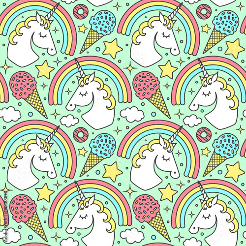 Materiał do szycia Seamless pattern with unicorn and rainbow on green background. Vector cartoon style cute character
