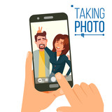 Taking Photo On Smartphone Vector. Smiling Friends Taking Selfie. People Posing. Hand Holding Smartphone. Friendship Concept. Isolated Flat Cartoon Illustration - 190518604