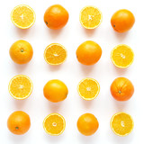 Creative flat layout of fruit, top view. Sliced orange isolated on white background. Food wallpaper, composition pattern of fresh citrus fruits.