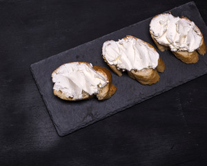 three sandwiches with creamy white cheese