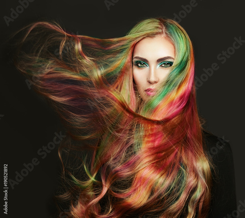 In de dag Kapsalon Portrait of young beautiful woman with long flowing hair. Model with perfect Healthy Dyed Hair. Rainbow Hairstyles