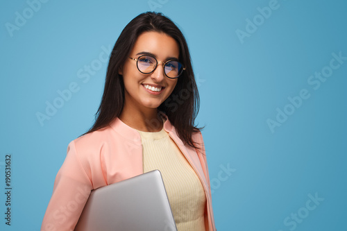Smiling woman with tablet