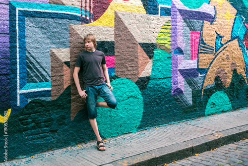 young guy teenager near a painted wall - 190533005