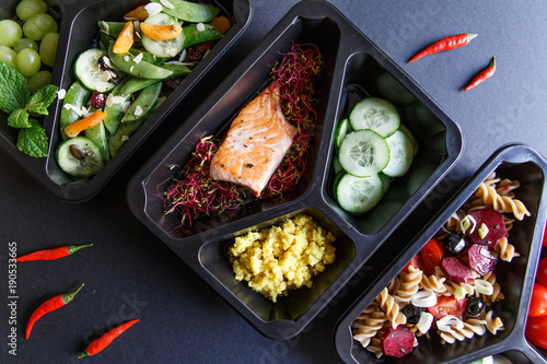 Foto Murales Healthy food and diet concept. Dietary catering. Restaurant dish delivery. Fitness meal. Take away. Fit and eat. Weight loss nutrition in foil boxes.