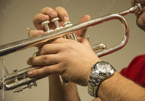 Hands playing trumpet Poster