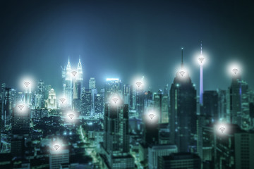 Cityscape of Kuala lumpur city skyline with wireless connecting at night in Malaysia. Vintage tone