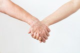 close up of senior and young woman holding hands - 190541683
