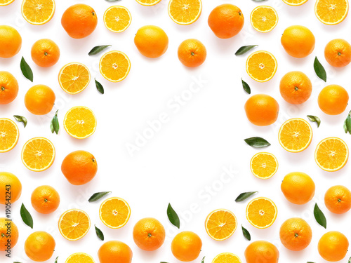 frame of fresh oranges isolated on white background, top view, flat lay. Food texture background. Healthy food, detox, diet.