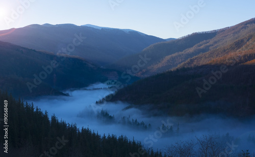 Foto op Canvas Herfst Mist of sea, Sea of clouds on sunrise with ray lighting in valley of Goizueta