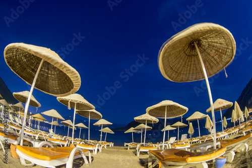 Fotobehang Athene sunshade beach umbrellas against night sky in Turkey