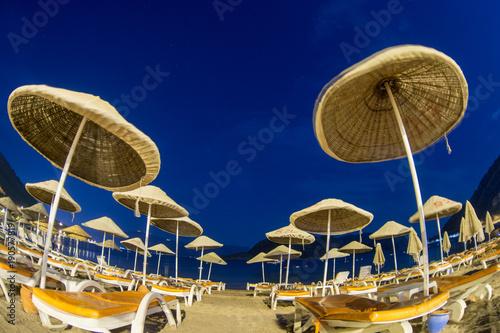 Deurstickers Athene sunshade beach umbrellas against night sky in Turkey