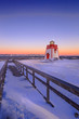 snow covered landscape with lighthouse during blue hour