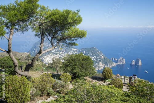 Bright scenic view of the iconic Faraglioni rocks from the cliffside trail on the Mediterranean island of Capri, Italy