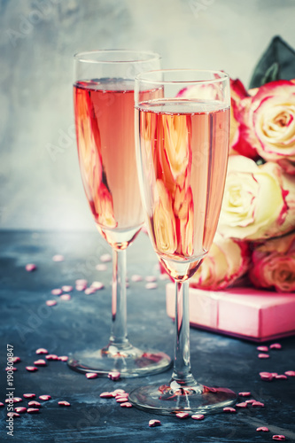 Plagát Bouquet of white and red roses, gift box, glasses with pink champagne for a pair of lovers for St