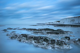 Stunning long exposure landscape image of low tide beach with rocks at sunrise - 190606475