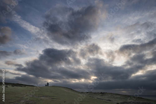 Foto op Aluminium Donkergrijs Stunning landscape image of Belle Tout lighthouse on South Downs National Park during stormy sky