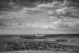 Stunning black and white landscape image of Belle Tout lighthouse on South Downs National Park during stormy sky - 190606873