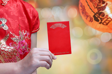 chinese woman holding new year red envelope or hong bao , text mean best whishes for you.
