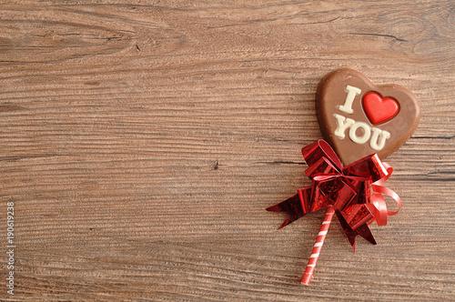 A heart shape chocolate lollipop with the words I love you