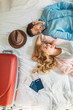 overhead view of couple of tourists lying on bed in hotel room