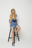 Smiling blond woman in dungarees, portrait - 190626019
