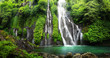 Leinwanddruck Bild - Jungle waterfall cascade in tropical rainforest with rock and turquoise blue pond. Its name Banyumala because its twin waterfall in mountain slope