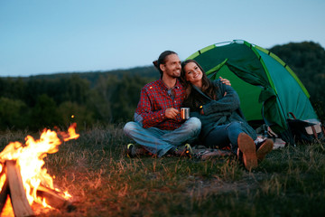Romantic Weekend. Couple In Love Near Camping In Nature.