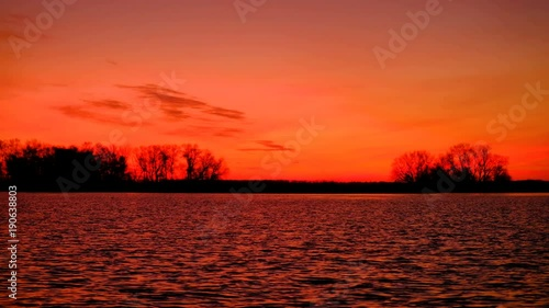 Foto op Canvas Baksteen Colorful sunset over sea. Red and orange sky. Fast waves