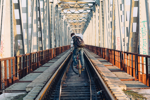 Fotobehang Fiets Riding on the bike on the bridge