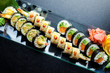 Sushi rolls set served on glass plate on dark background - 190656489