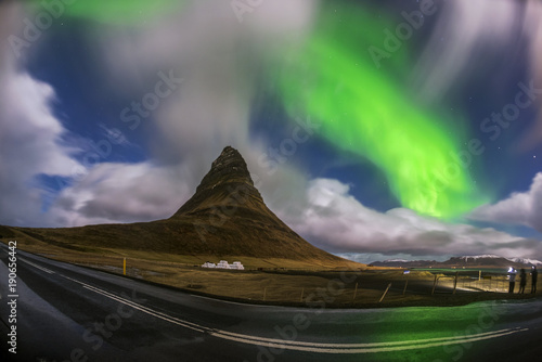 In de dag Nachtblauw Aurora blasted in sky over Kirkjufell mountain at night, Iceland