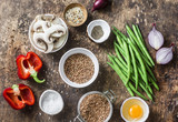 Flat lay healthy vegetarian food ingredients for lunch on a wooden background, top view. Buckwheat, green beans, sweet peppers, red onion, mushrooms, egg - clean eating vegetarian food concept - 190674251
