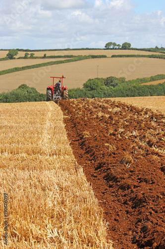 Fotobehang Trekker Vintage tractor ploughing