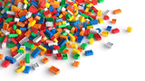 Pile of colored toy bricks on white background.