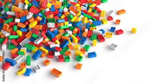 Fototapeta Pile of colored toy bricks on white background.