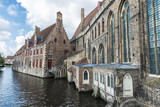 Old traditional houses along the river in Bruges, Belgium - 190677824