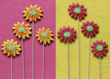 Gingerbread flowers on yellow and pink felt background.