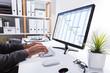 Businessperson Working On Gantt Chart Using Computer