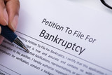 Person Filling Bankruptcy Form - 190684495