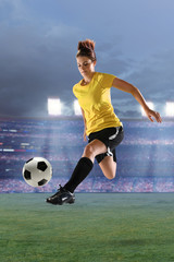 Female Soccer Player in Action