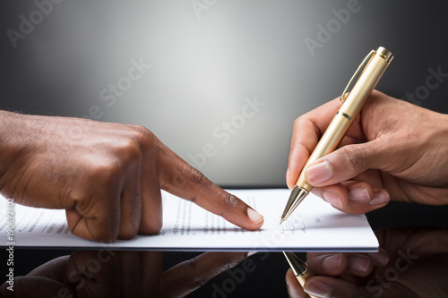 Person Signing On Document