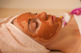 Attractive young woman with facial mask. Spa concept. - 190693229
