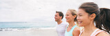 Group of three multiracial friends running together having fun on beach vacation. Young people, Asian woman, Caucasian blonde girl and man, active outdoors summer lifestyle banner. - 190696063