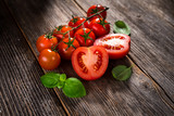 Fresh  tomatoes on rustic background - 190698606