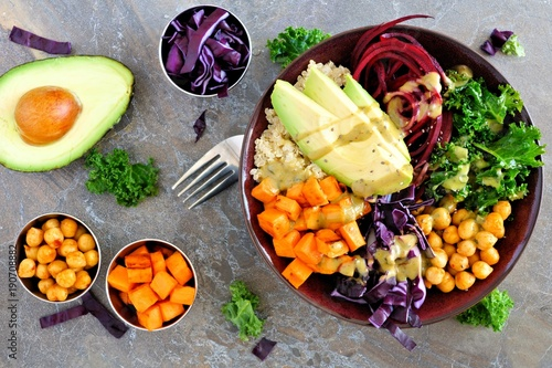 Buddha bowl with quinoa, avocado, chickpeas, vegetables on a dark stone background, Healthy eating concept. Overhead scene. - 190708882