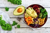 Buddha bowl with quinoa, avocado, chickpeas, vegetables on a white wood background, Healthy food concept. Top view. - 190709825