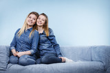 Two happy women friends wearing jeans outfit poitning - 190726467