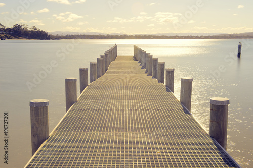 Pier on the water in the town of Swansea, Tasmania.
