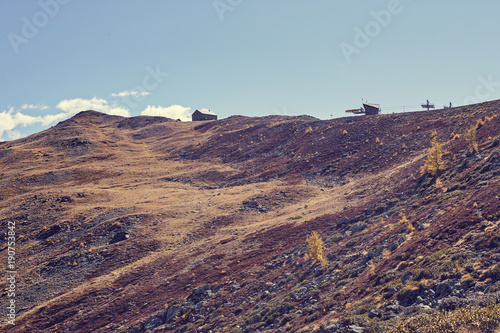 Fotobehang Bleke violet house and ski lift in a wild mountain in autumn
