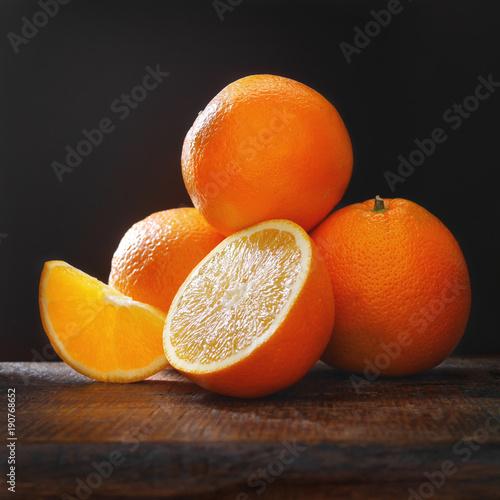 Oranges on a dark background.